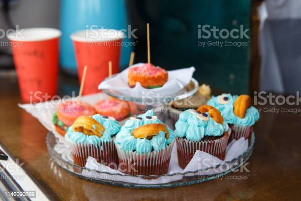 Photo of Cakes in the form of burgers and muffins