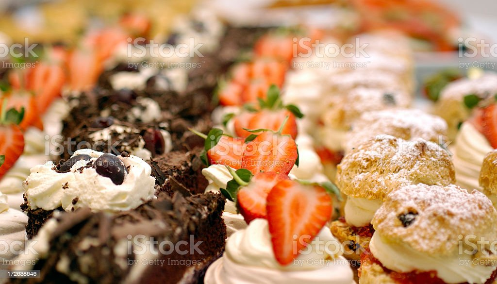 cakes on a buffet table line up stock photo