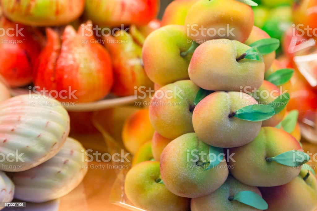 Cakes with marzipan in the form of peach. stock photo