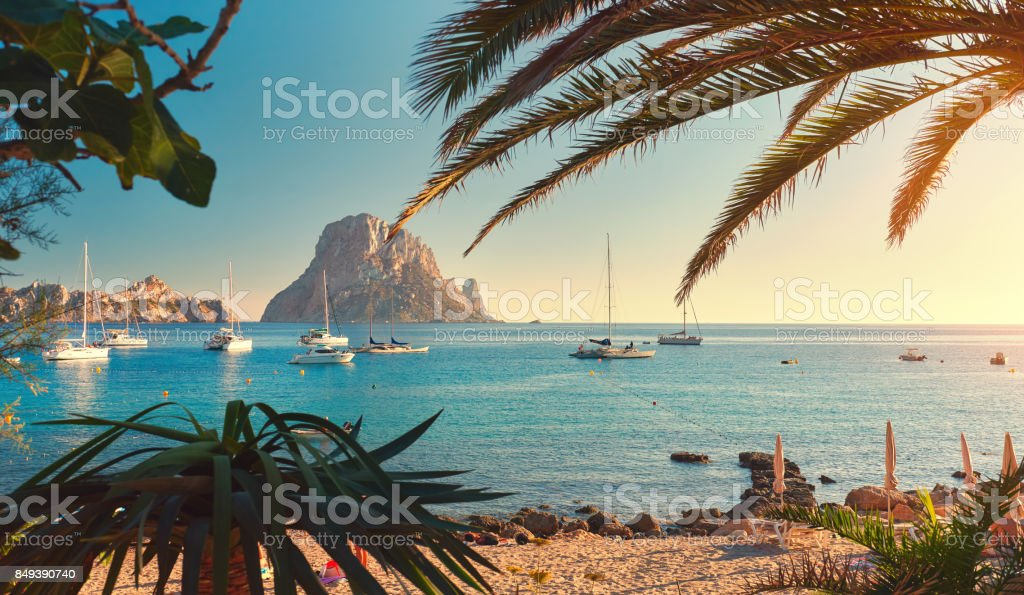 Cala d'Hort beach Cala d'Hort beach. Cala d'Hort in summer is extremely popular, beach have a fantastic view of the mysterious island of Es Vedra. Ibiza Island, Balearic Islands. Spain Arts Culture and Entertainment Stock Photo