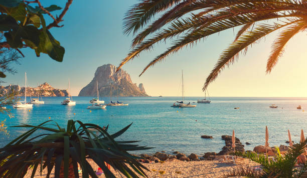 Cala d'Hort beach Cala d'Hort beach. Cala d'Hort in summer is extremely popular, beach have a fantastic view of the mysterious island of Es Vedra. Ibiza Island, Balearic Islands. Spain mediterranean sea stock pictures, royalty-free photos & images
