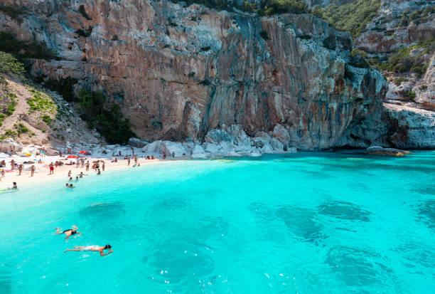 Cala Gonone, Sardinia, Italy, Cala Mariolu - Beach with unidentifiable people stock photo