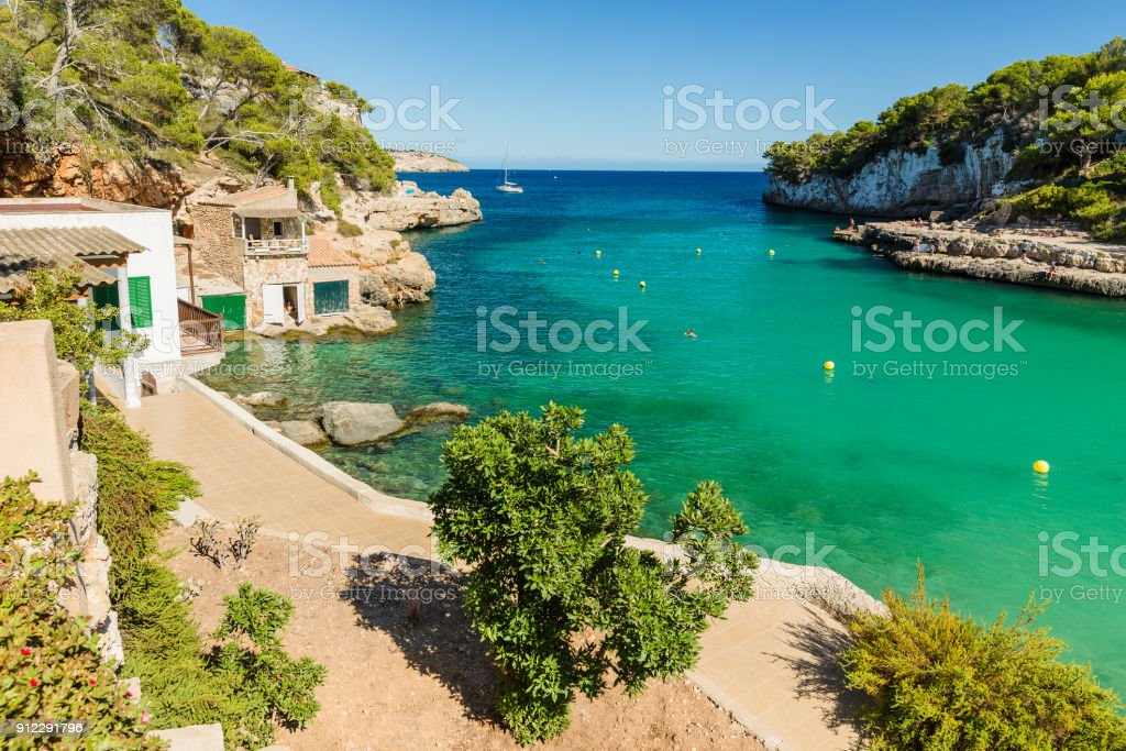 Cala Llombards. Beautiful beach that is sheltered on either side by cliffs. Mallorca island, Spain. stock photo