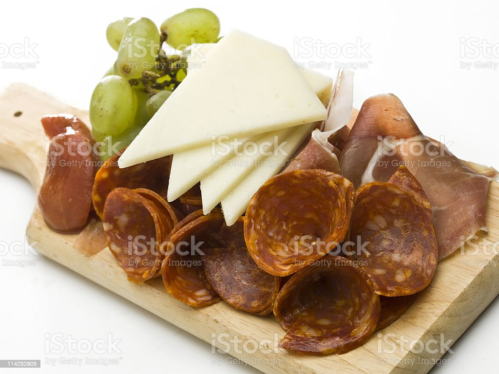 Calabrese, cheese and grapes ready to eat on a table stock photo