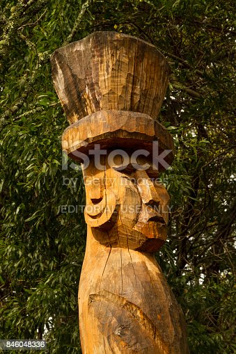 Panguipulli, Chile - September 17, 2014: Mapuchean totem face at Calafquen river at south Chile.