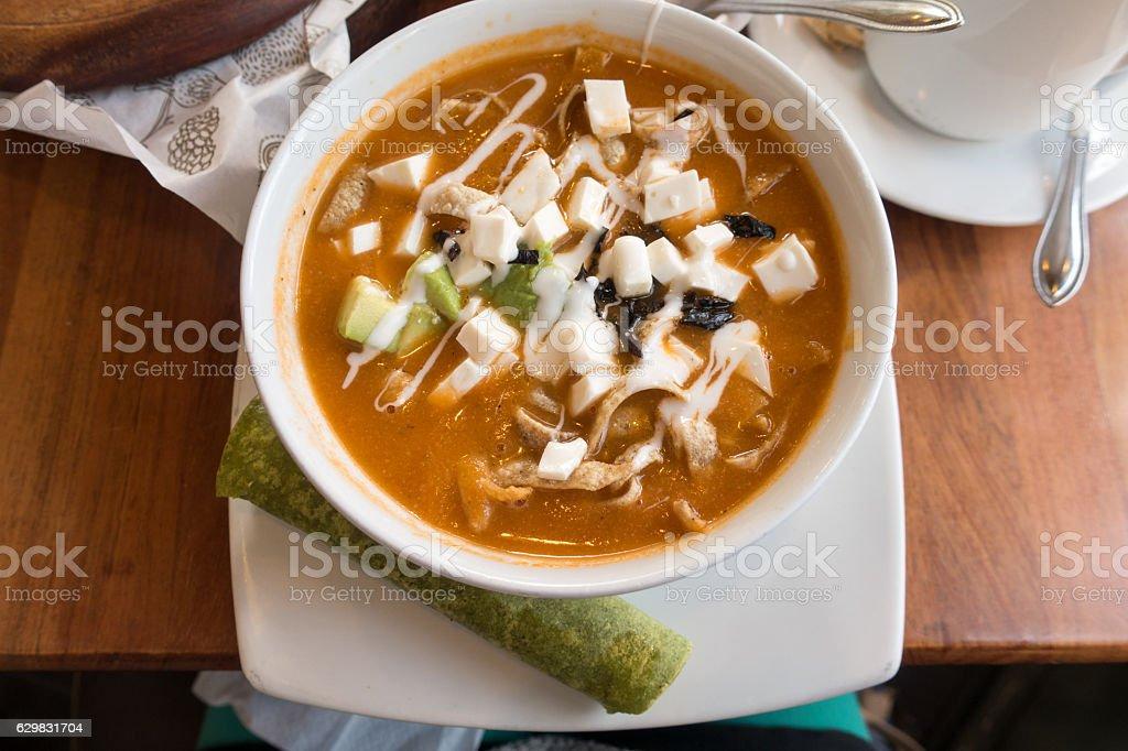 Calamari and Cotija Cheese Soup With Avocado and Green Burrito stock photo