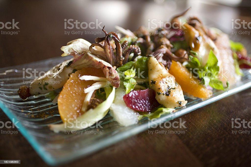 calamari salad with citrus slices royalty-free stock photo