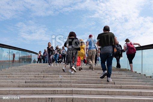 Venice, Italy - May 11, 2018: Tourists walk up the Calatrava bridge