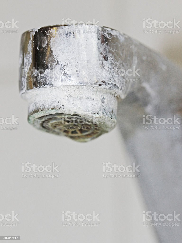 Calcified bathroom fittings in a hotel stock photo