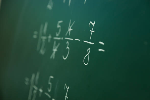 Calcualting with fractions stock photo