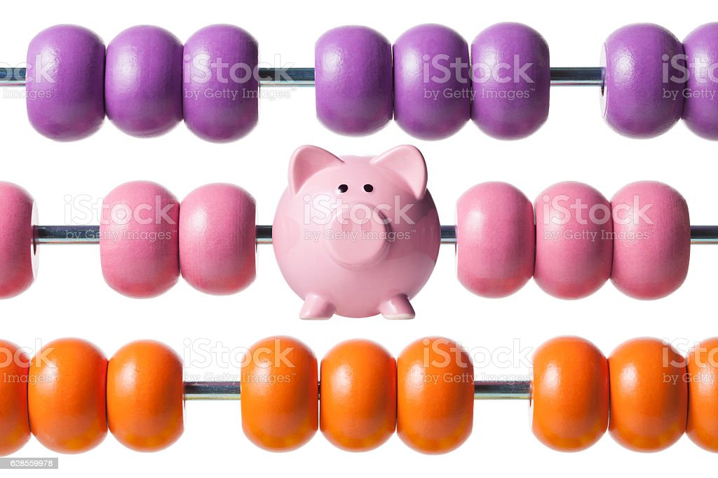 Calculate savings. Abacus with piggy bank. stock photo