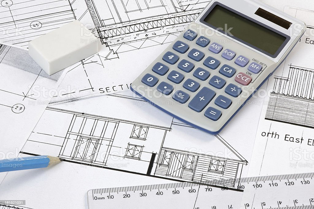 Calculater,pencil and ruler on Plans royalty-free stock photo