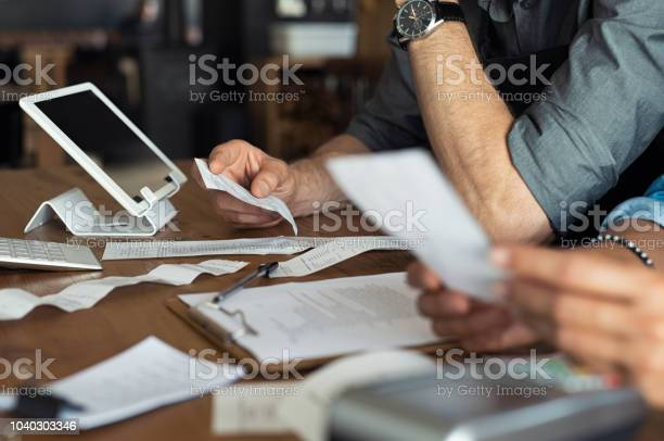 Calculating Business Expenses Stock Photo - Download Image Now