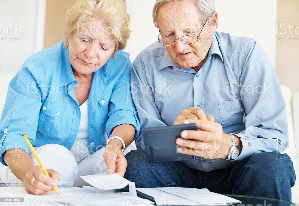 Calculating finances at home stock photo