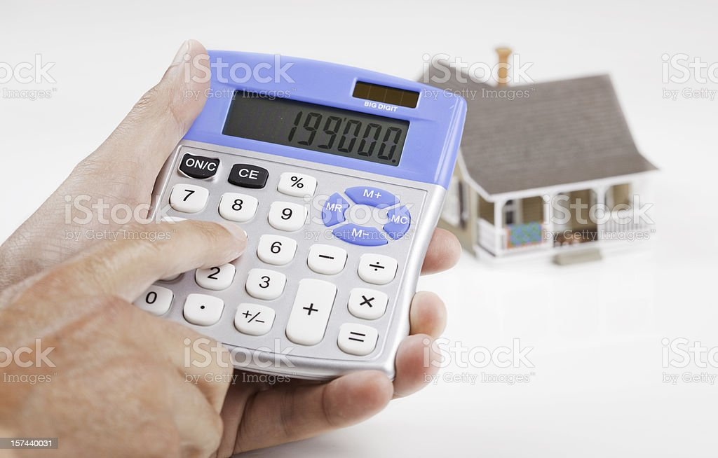 Calculating House Mortgage royalty-free stock photo