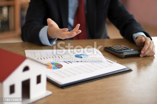 626187670istockphoto calculating housing sales 1164133925