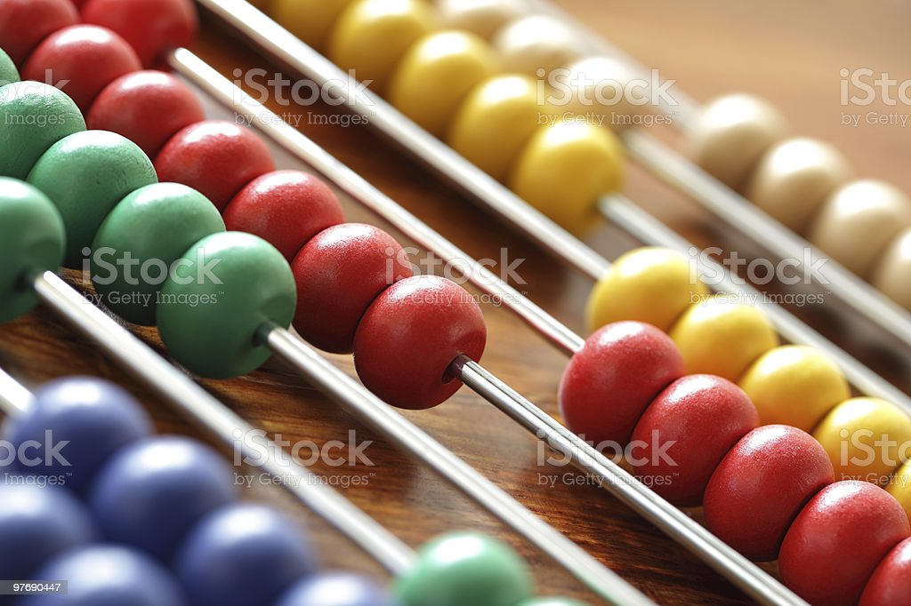 Calculating on an abacus stock photo