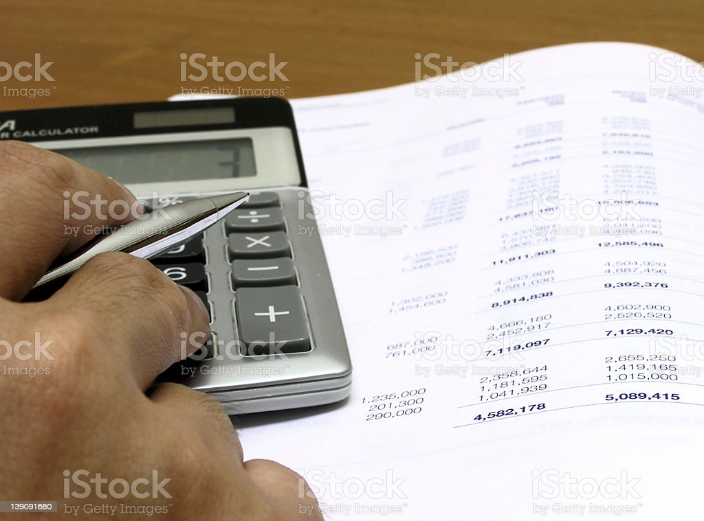 calculating profit (low angle) stock photo