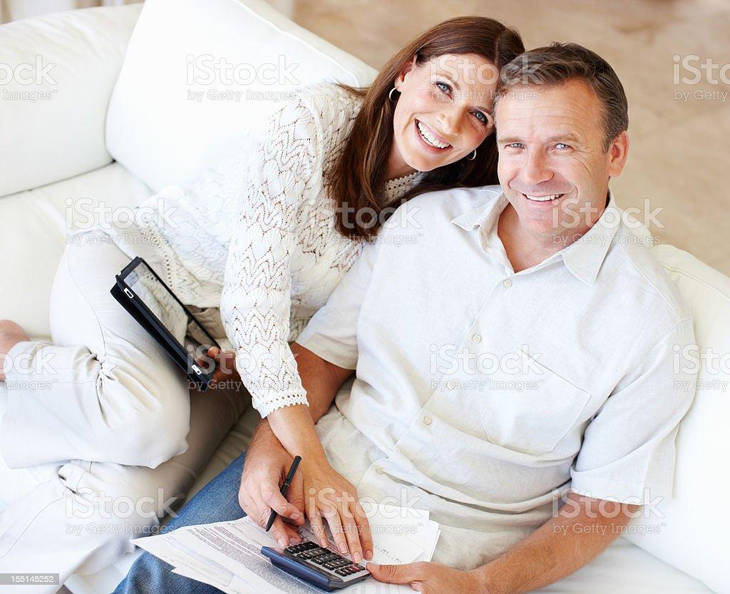 Calculating savings at home royalty-free stock photo