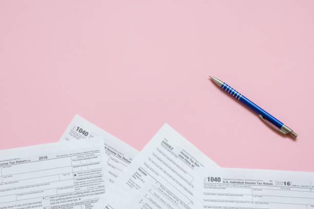 Calculating taxes concept stock photo