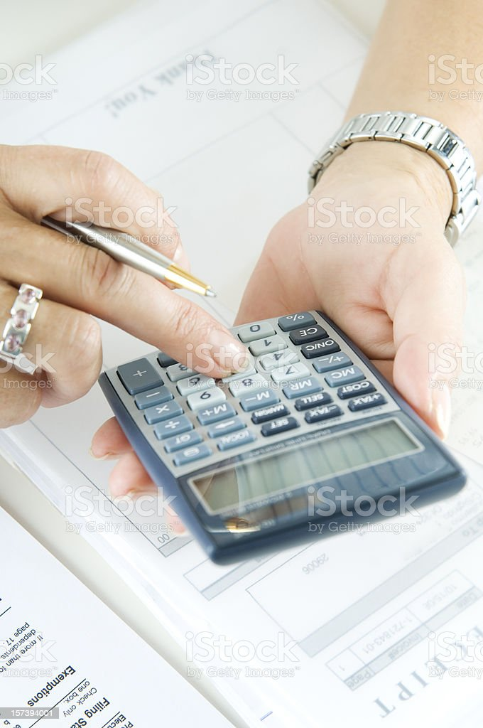 Calculating taxes royalty-free stock photo