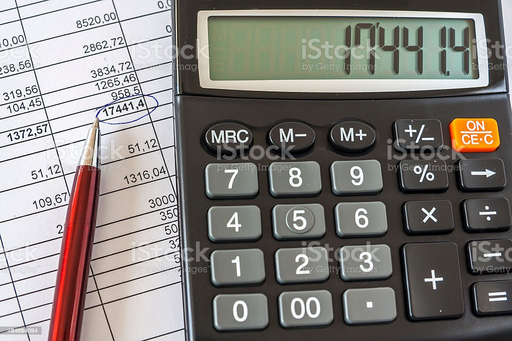 Calculator And Ballpoint On Financial Document stock photo