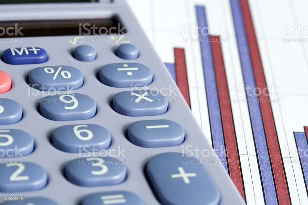 Calculator and bar chart royalty-free stock photo