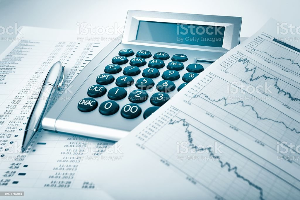 Calculator and charts and documents royalty-free stock photo