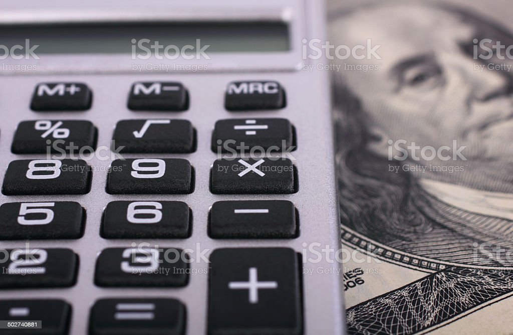Calculator and dollar stock photo