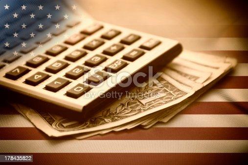 istock Calculator and Dollars 178435822
