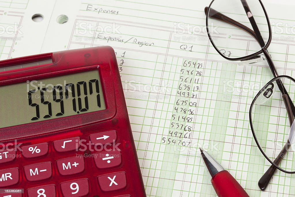 Calculator and expense ledger - Q1 stock photo
