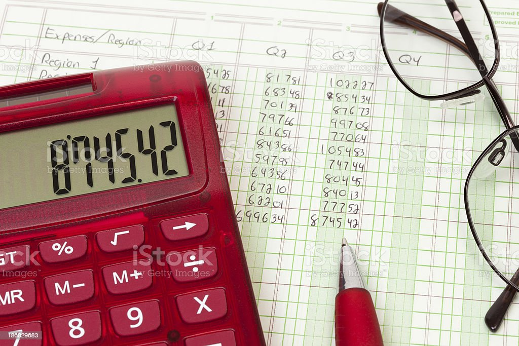 Calculator and expense ledger - Q3 royalty-free stock photo