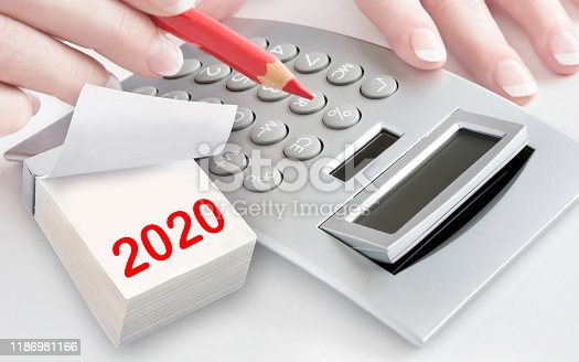 1170746979istockphoto Calculator and female hand calendar 2020 1186981166