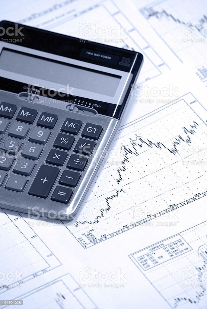 Calculator and finance charts royalty-free stock photo