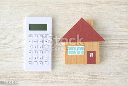 Calculator and house toy