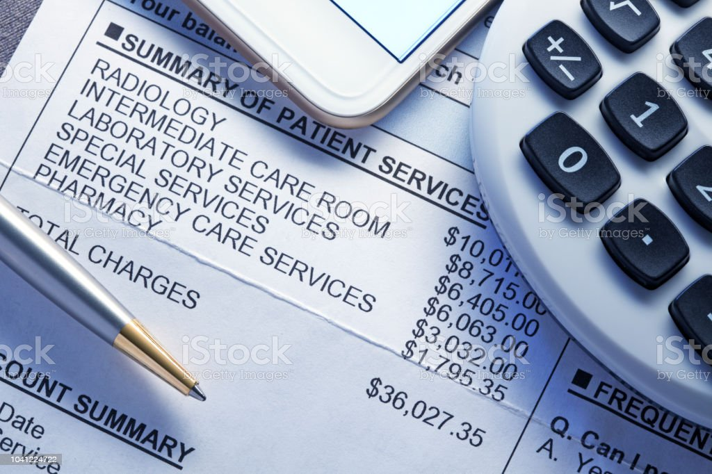 Calculator And Mobile Phone On Top Of Medical Invoice stock photo