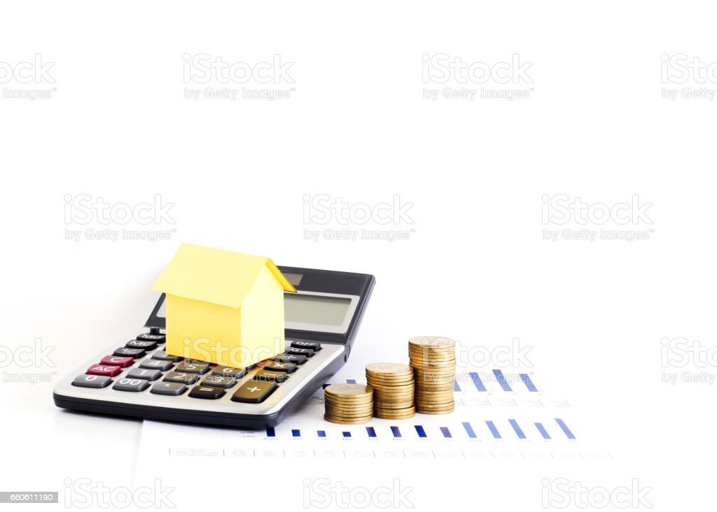 Calculator and money coins stack with house paper for loans concept royalty-free stock photo