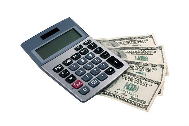 Calculator and money stock photo
