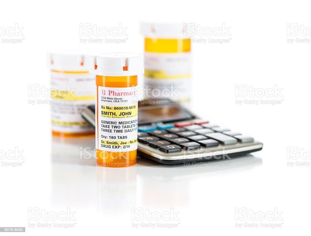 Calculator and Non-Proprietary Medicine Prescription Bottles Iso stock photo