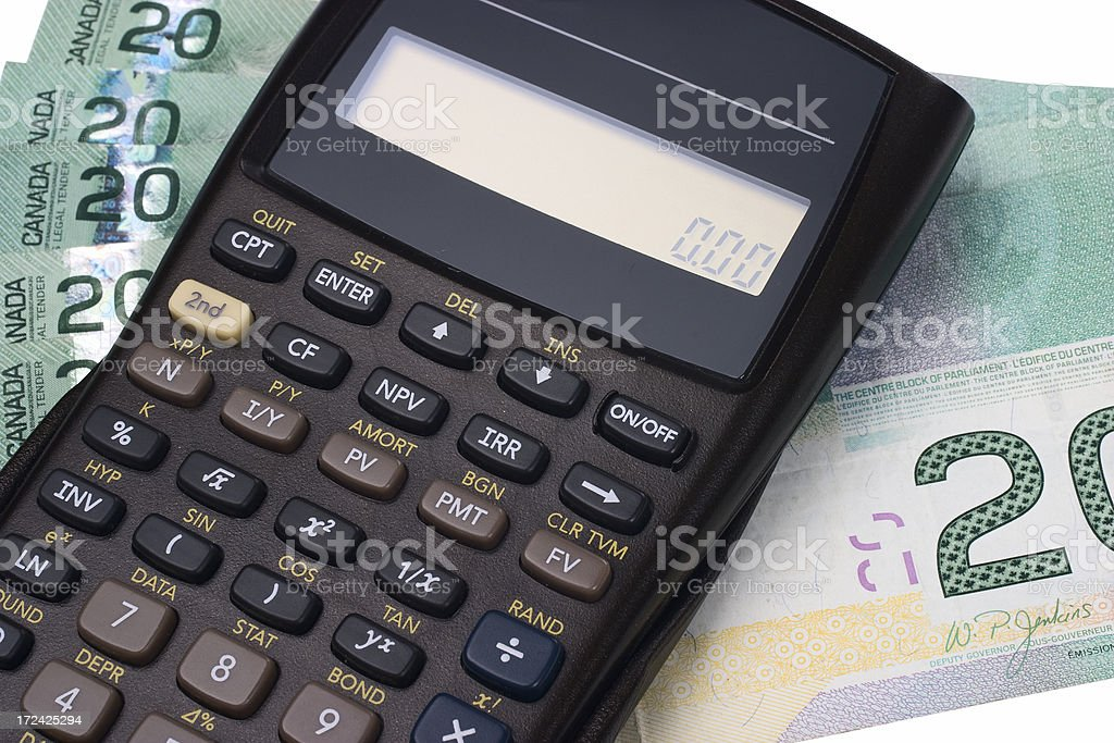 A calculator and paper money notes stock photo
