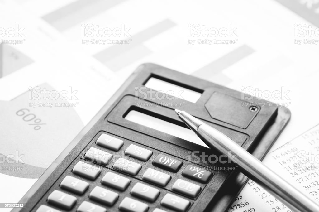 calculator and pen on book finance and account stock photo