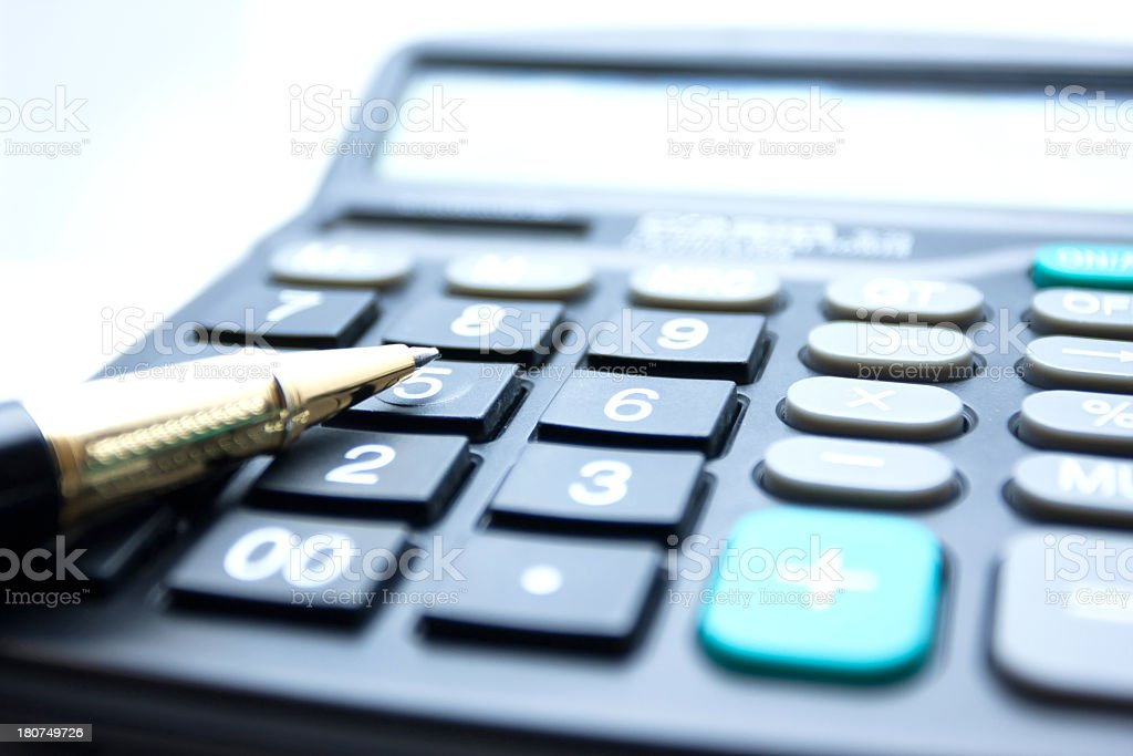 Calculator and pen stock photo