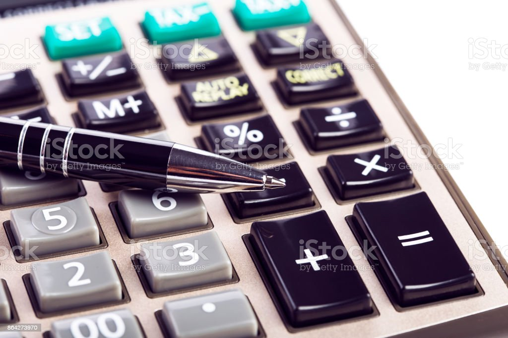Calculator and pen royalty-free stock photo