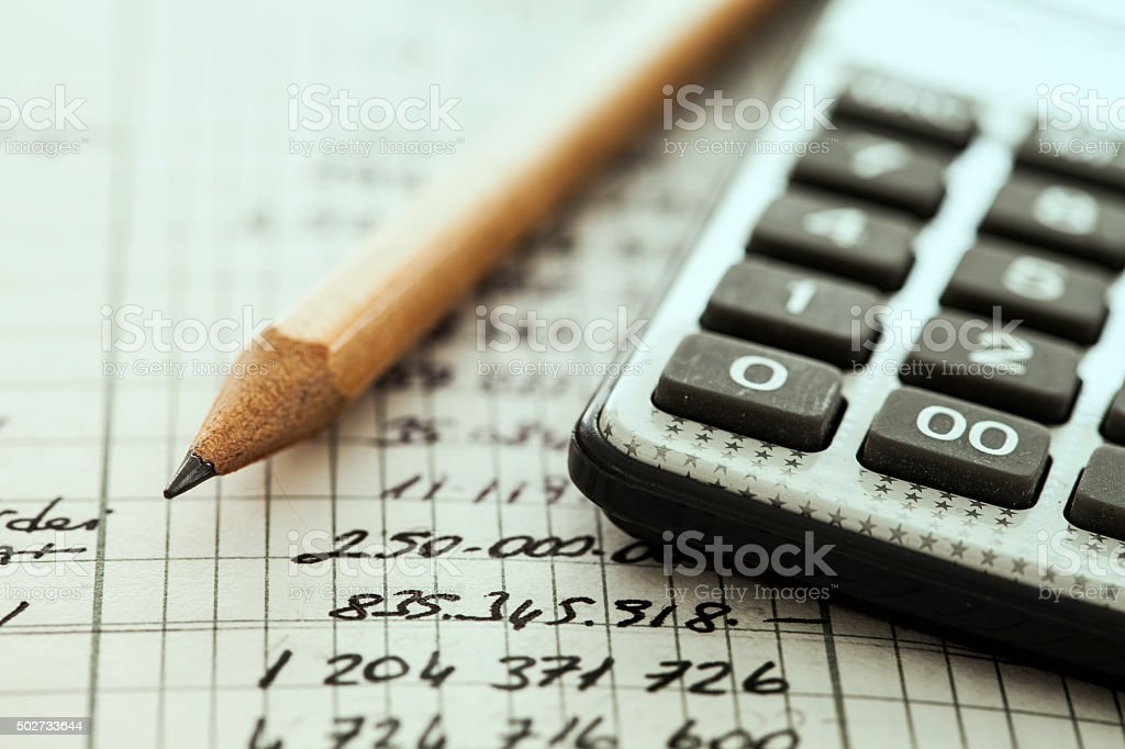 Calculator and pencil stock photo