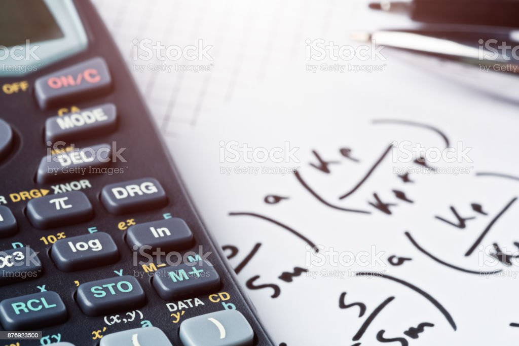 Calculator And Pens On Complex Equation Stock Photo More Pictures