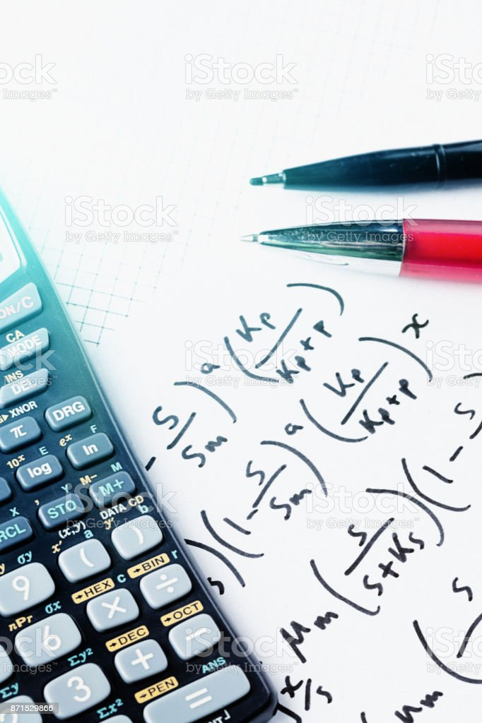 Calculator And Pens On Complex Mathematical Equation Stock Photo ...