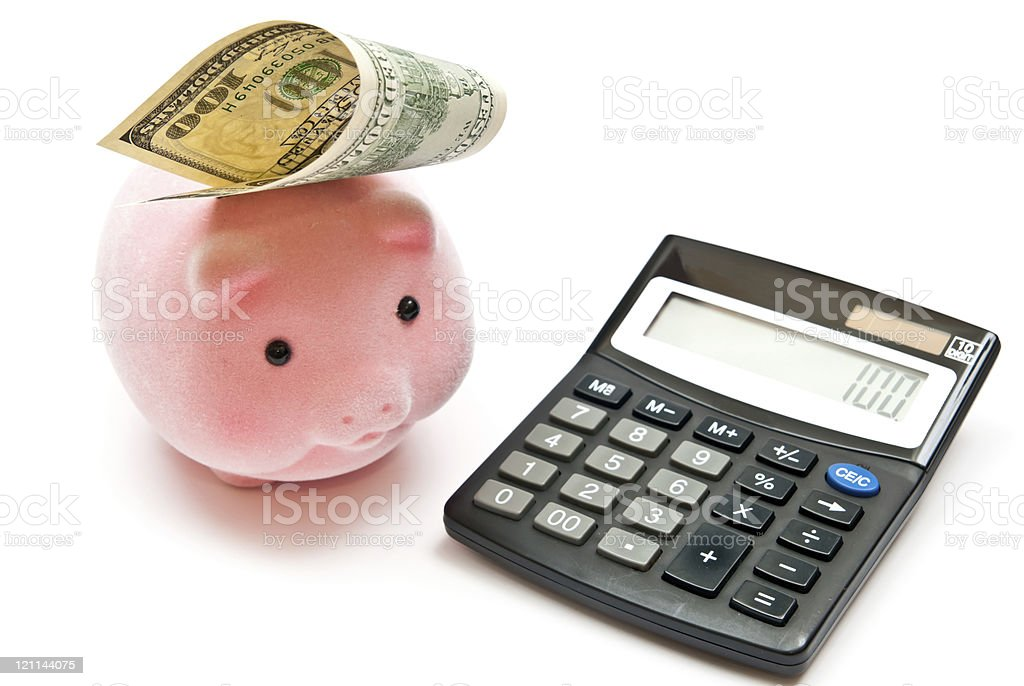 Calculator and piggy bank royalty-free stock photo