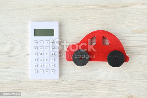 Calculator and red car toy