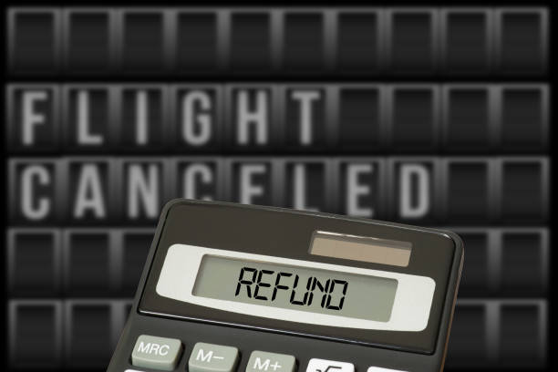 Calculator and refund for cancelled flight stock photo