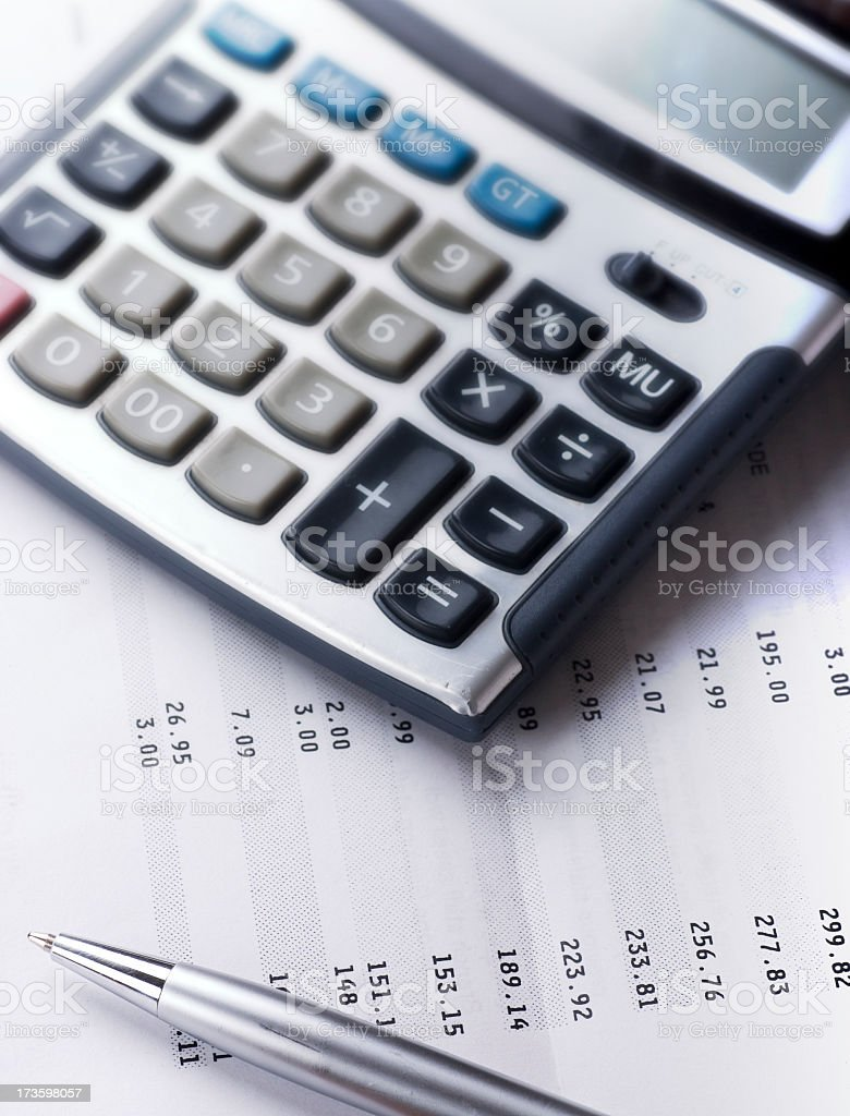 Calculator and silver pen to calculate bills royalty-free stock photo